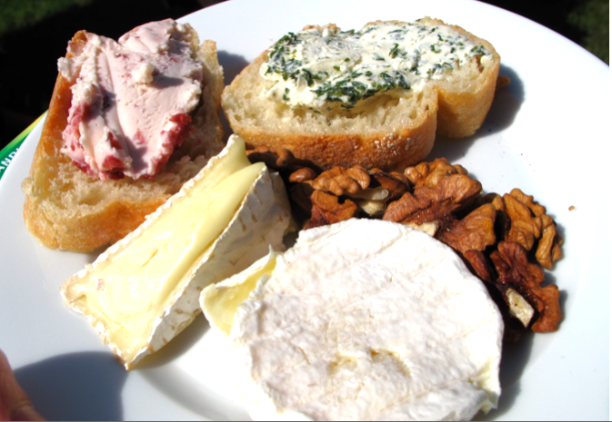 Selection of French cheeses - bire, roulade with cranberries and herbs and chabocou