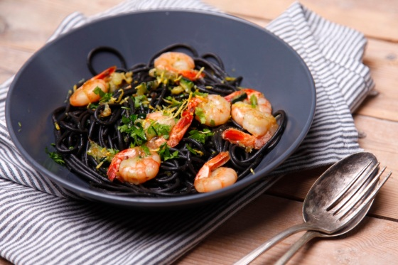 Linguine nero di seppia with prawns, courgette and lemon